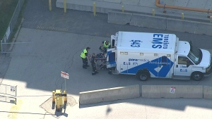 A teenage boy is loaded into an ambulance after being struck by a vehicle in Etobicoke on June 24. (Chopper 24)