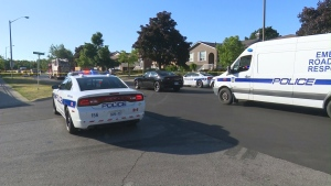 Police vehicles are seen after a teenage girl was struck in Brampton on Thursday, June 24, 2016.