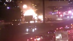 Flames can be seen following a serious crash in the southbound lanes of Highway 400, south of Sheppard Avenue, on Friday, June 24, 2016.