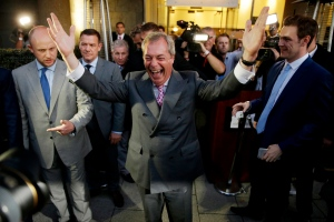 "In this Friday, June 24 2016 file photo Nigel Farage, the leader of the UK Independence Party, celebrates and poses for photographers as he leaves a ""Leave.EU"" organization party for the British European Union membership referendum in London. (AP Photo/Matt Dunham, File)"