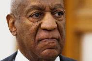 In this May 24, 2016 file photo, Bill Cosby departs the Montgomery County Courthouse after a preliminary hearing, in Norristown, Pa. A 72-year-old New Hampshire woman who says Bill Cosby raped her in 1965 has withdrawn her civil defamation lawsuit against the comedian after a federal judge had allowed the case to move forward. (AP Photo/Matt Rourke, File)