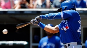 Toronto Blue Jays' Devon Travis hits a single against the Chicago White Sox during the first inning of a baseball game in Chicago, Saturday, June 25, 2016. (AP Photo/Nam Y. Huh)