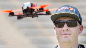 Professional drone racer Ryan Walker pilots a drone during the Montreal drone expo, Saturday, June 25, 2016. THE CANADIAN PRESS/Graham Hughes