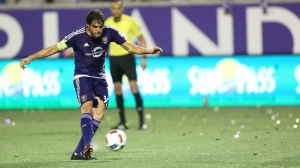 Orlando City midfielder Adrian Winter, right, goes after the ball during an MLS soccer game against Toronto FC Saturday, June 25, 2016, in Orlando, Fla. (Ricardo Ramirez Buxeda/Orlando Sentinel via AP)
