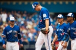 Toronto Blue Jays relief pitcher Gavin Floyd (39) looks down while playing against the Boston Red Sox during 11th inning AL baseball action in Toronto on Sunday, May 29, 2016. THE CANADIAN PRESS/Nathan Denette