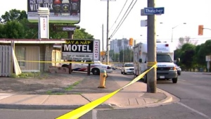 Police investigate a suspicious death after a woman was found dead at a motel in the Kingston and Brimley roads area in Scarborough Sunday June 26, 2016.