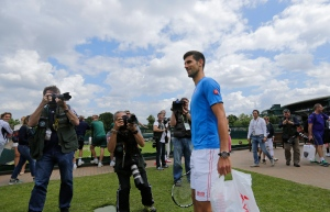 Novak Djokovic of Serbia arrives for a training session the day before the Wimbledon Tennis Championships in London, Sunday, June 26, 2016. (AP Photo/Ben Curtis)
