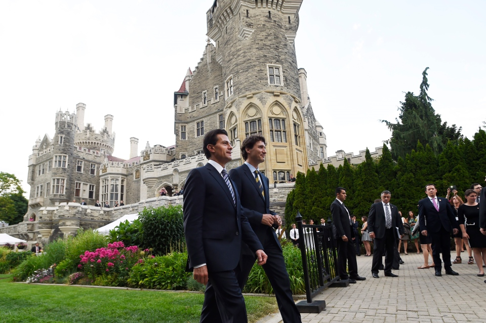 Canadian Prime Minister Justin Trudeau, right, and Mexican President Enrique Pena Nieto talk as they walk to a dinner at Casa Loma in Toronto on Monday, June 27, 2016. THE CANADIAN PRESS/Nathan Denette