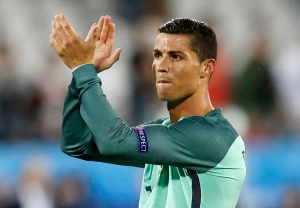 Portugal's Cristiano Ronaldo applauds fans at the end of the Euro 2016 round of 16 soccer match between Croatia and Portugal at the Bollaert stadium in Lens, France, Saturday, June 25, 2016. (AP Photo/Frank Augstein)