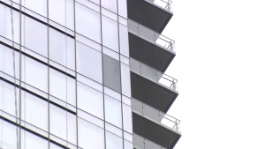 A fractured pane of glass is seen on the side of the Four Seasons Hotel in Yorkville on June 28. (CP24)