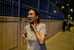 A woman stands and cries outside Istanbul's Ataturk airport, Tuesday, June 28, 2016. (AP Photo)