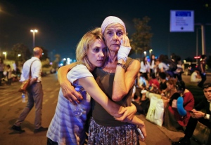 Passengers embrace each other as they wait outside Istanbul's Ataturk airport, early Wednesday, June 29, 2016 following their evacuation after a blast. (AP Photo/Emrah Gurel)