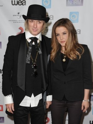 In this May 10, 2012 file photo, Lisa Marie Presley, at right, and her husband, Michael Lockwood, arrive at NARM Music Biz 2012 Awards, at The Hyatt Regency in Century City, Calif. Court records released Tuesday, June 28, 2016, show Presley filed to divorce her fourth husband, guitarist Lockwood, after more than 10 years of marriage. (AP Photo/Katy Winn, File)