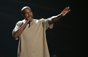 FILE - In this Aug. 30, 2015, file photo, Kanye West accepts the video vanguard award at the MTV Video Music Awards at the Microsoft Theater in Los Angeles. West and Adidas are expanding their partnership that began almost two years ago with retail hubs for his Yeezy products and additional sportswear designs. The sportswear company announced the collaboration on Wednesday, June 29, 2016, and described it as the most significant partnership between a non-athlete and an athletic brand. (Photo by Matt Sayles/Invision/AP, File)