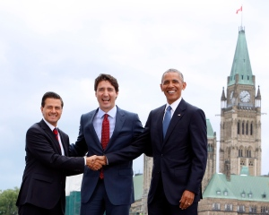 Prime Minister Justin Trudeau (centre), Mexican President Enrique Pena Nieto(left) and U.S. President Barack Obama(right) take part in a family photo at the North American Leaders' Summit in Ottawa, Wednesday June 29, 2016. THE CANADIAN PRESS/Fred Chartrand