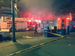 Two firefighters were injured after a five-alarm fire broke out at a building on Dundas Street, near Palmerston Avenue. (Mike Nguyen/ CP24)