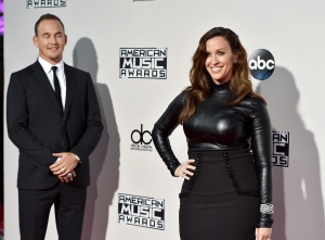 FILE - In this Nov. 22, 2015, file photo, Souleye, left, and Alanis Morissette arrive at the American Music Awards in Los Angeles. Morissette posted a nude photo of herself sporting a large baby bump while floating underwater on Instagram on June 28, 2016. (Photo by Jordan Strauss/Invision/AP, File)