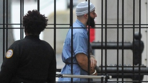 Adnan Syed enters Courthouse East in Baltimore prior to a hearing on Wednesday, Feb. 3, 2016. (Barbara Haddock Taylor/The Baltimore Sun via AP, File)