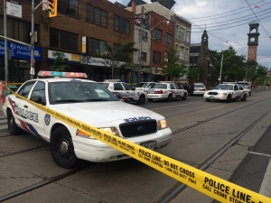 Police tape is shown at the scene of a deadly shooting on College Street at Augusta Avenue on Friday, July 1. (Tracy Tong)
