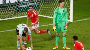 Wales' Hal Robson Kanu, center, celebrates scoring his team's second goal during the Euro 2016 quarterfinal soccer match between Wales and Belgium, at the Pierre Mauroy stadium in Villeneuve d'Ascq, near Lille, France, Friday, July 1, 2016. (AP Photo/Michael Sohn)