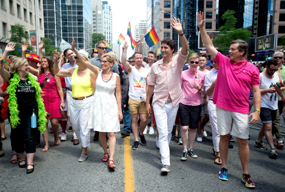 Green Party Leader Elizabeth May, front left to right, Ontario Premier Kathleen Wynne, Prime Minister Justin Trudeau and Toronto Mayor John Tory wave to spectators at the annual Pride Parade in Toronto on Sunday, July 3, 2016. THE CANADIAN PRESS/Nathan Denette