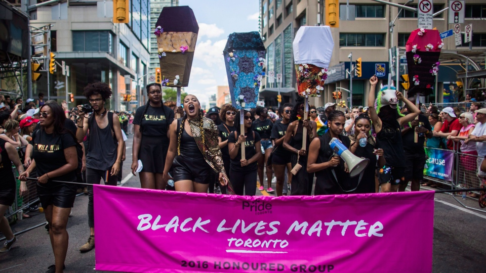 People from the Black Lives Matter lead the annual Pride Parade, in Toronto on Sunday, July 3, 2016. THE CANADIAN PRESS/Mark Blinch