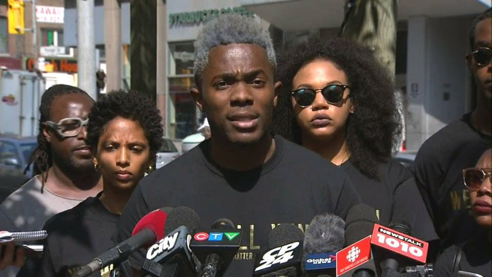 Black Lives Matter Toronto Co-founder Rodney Diverlus speaks with reporters on Thursday.