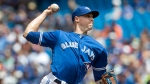 Toronto Blue Jays starting pitcher Aaron Sanchez throws against the Detroit Tigers during the first inning of their American League MLB baseball game in Toronto Saturday July 9, 2016. THE CANADIAN PRESS/Fred Thornhill