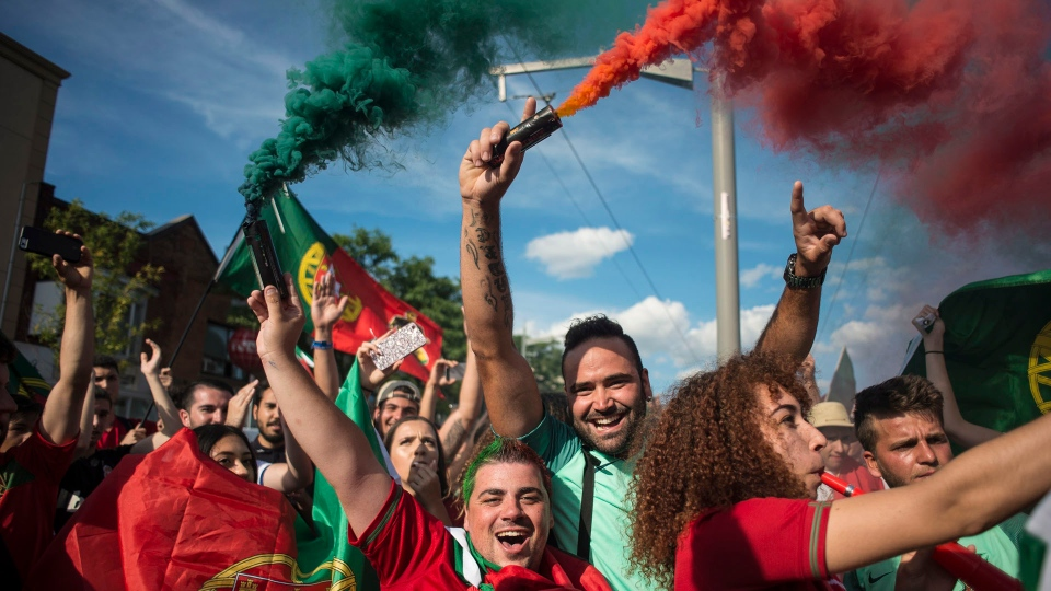 Fans pack streets in Little Portugal after team wins Euro 2016 | CP24.com