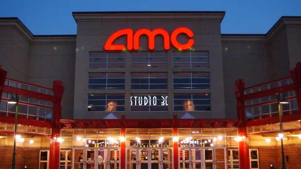 In this May 11 ,2005 file photo, people enter AMC's Studio 30 theatre in Olathe, Kan. (AP / Orlin Wagner)