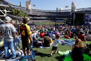 Fans sit in the outfield prior to the MLB baseball All-Star Game, Tuesday, July 12, 2016, in San Diego. (AP Photo/Jae C. Hong)
