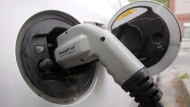 A charging electric vehicle is shown in this photo.  (Toby Talbot/The Canadian Press)