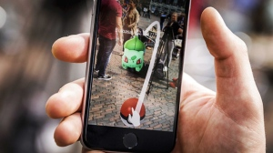 A close-up view of a gamer playing the Pokemon Go app on the Grote Markt in Haarlem, The Netherlands, in an image dated July 13, 2016. The game, that uses the GPS to locate the smartphone's location, has gained a huge popularity among smartphone users and added to the value of Nintendo that partly owns the franchise enterprise that makes Pokemon.  EPA/REMKO DE WAAL