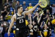 Wichita State's Fred VanVleet points to fans after the team's First Four game against Vanderbilt in the NCAA mens college basketball tournament, Tuesday, March 15, 2016, in Dayton, Ohio. (AP Photo/John Minchillo)