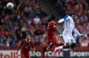 Canada's Tosaint Ricketts (11) and Honduras' Romell Quioto, right, vie for the ball during second half CONCACAF 2018 World Cup qualifying soccer action in Vancouver, B.C., on Friday, Nov. 13, 2015. (The Canadian Press/Darryl Dyck)