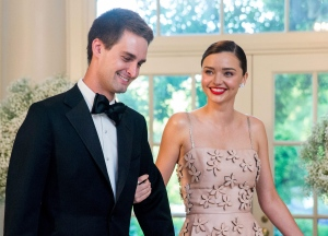 In this May 13, 2016 file photo, model Miranda Kerr, right, and her boyfriend, Snapchat CEO Evan Spiegel, arrive for a state dinner for Nordic leaders at the White House in Washington. (AP Photo/Andrew Harnik)