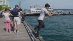 Comedian Mark Correia stumbles into Lake Ontario while looking for Pokemon in a still image from a YouTube video. (Noodle Boys/ YouTube)