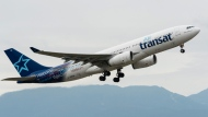 This file photo shows an Air Transat Airbus A330 (A330-200) jet airliner taking off from Vancouver International Airport, May 21, 2016. THE CANADIAN PRESS IMAGES/Bayne Stanley