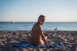 Stephane Deschenes, nudist and owner of Bare Oaks Family Naturist Park, poses for a photo at Hanlan's Point beach on Toronto Island on Thursday, July 14, 2016. THE CANADIAN PRESS/Aaron Vincent Elkaim