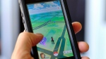 "In this Friday, July 8, 2016, file photo, ""Pokemon Go"" is displayed on a cell phone in Los Angeles. Pokemon Go's origins are as peculiar as any of the creatures inhabiting the game. (AP Photo/Richard Vogel, File)"