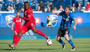 Toronto FC forward Jozy Altidore (17) kicks the ball away from Montreal Impact midfielder Eric Alexander during first half MLS action on Saturday, April 23, 2016 in Montreal. (The Canadian Press/Paul Chiasson)