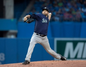 Seattle Mariners starting pitcher James Paxton throws against the Toronto Blue Jays during the third inning of their American League MLB baseball game in Toronto on Friday, July 22, 2016. (The Canadian Press/Fred Thornhill)