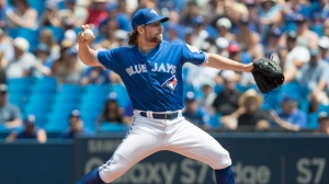 Toronto Blue Jays starting pitcher R.A. Dickey works against the Seattle Mariners during first inning American League MLB baseball action in Toronto on Saturday, July 23, 2016. THE CANADIAN PRESS/Fred Thornhill