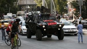 A police APC drives in the city center in Ankara, Turkey, Friday, July 22, 2016. Some Muslim faithful in Ankara welcomed Friday a declaration of a state of emergency by the top authorities, a move that gives President Recep Tayyip Erdogan sweeping powers in ruling the country.(AP Photo/Burhan Ozbilici)