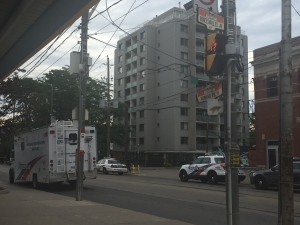 Police are shown at the scene of a fatal shooting on Howard Park Avenue near Roncesvalles Avenue on July 24. (Arda Zakarian)