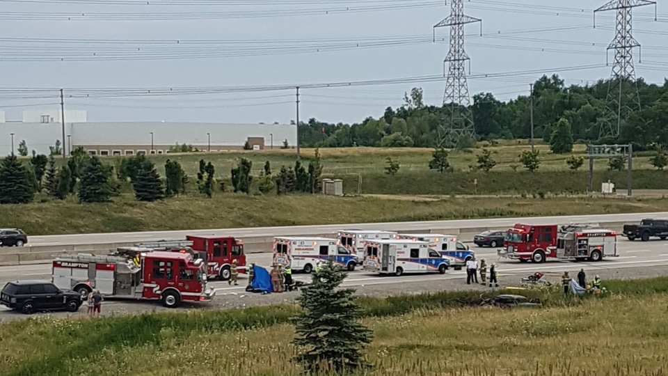 Emergency vehicles are pictured at the scene of a fatal collision on the westbound lanes of Highway 407 near Mississauga Road Sunday July 24, 2016. (ItsYaBoiChips /Twitter)