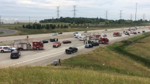 Emergency vehicles are pictured at the scene of a fatal collision on the westbound lanes of Highway 407 near Mississauga Road Sunday July 24, 2016. (Tracy Tong /CP24)