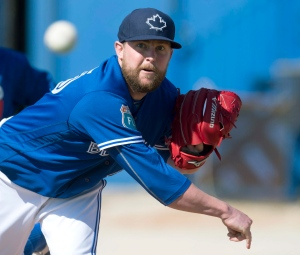 In this Feb. 25, 2016, file photo, Toronto Blue Jays pitcher Drew Storen pitches during baseball spring training in Dunedin, Fla. (Frank Gunn /The Canadian Press via AP, File)