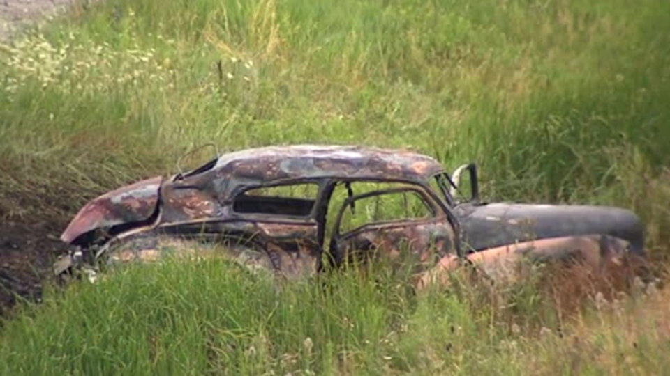 The charred remains of a 1948 Chevy are pictured after the vehicle was involved in a crash that left three of its occupants dead on Highway 407 near Mississauga Road in Brampton Sunday July 24, 2016.