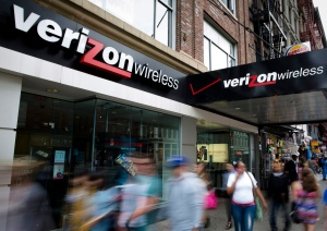 In this June 6, 2013, file photo, pedestrians pass a Verizon Wireless store on Canal Street in New York. (AP Photo/John Minchillo)